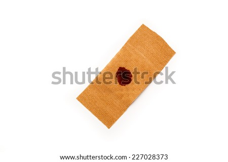 Band aid with artificial blood isolated on a white background. Wound, cure, care, relief. - stock photo