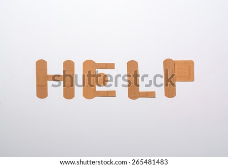 bandages forming the word help over white background - stock photo
