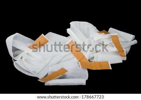 Bandages with plasters - stock photo