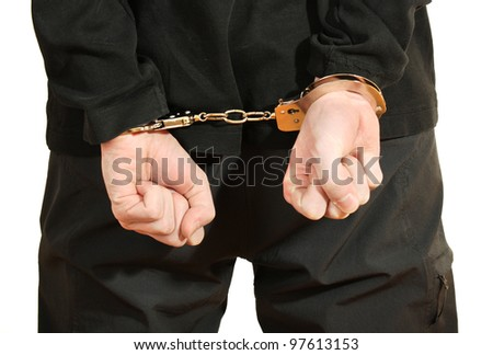 Bandit in black mask handcuffed isolated on white - stock photo