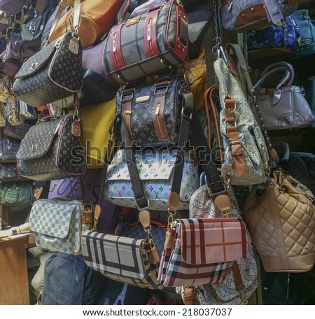 BANDUNG, WEST JAVA ISLAND, INDONESIA - SEPTEMBER 16, 2014: Large collection of famous fake handbags on display at one of the shopping centres in Bandung. Fake handbags are widely sold cheaply here. - stock photo