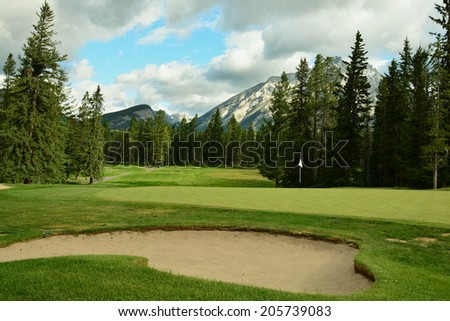 Banff, Alberta, Circa, July 2014.The iconic Rocky mountains of Banff, Alberta, Canada.Banff has many activities to keep all family members busy.Come enjoy Albertas hospitality. - stock photo