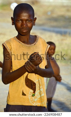 BANGANI NAMIBIE OCTOBER 10: Unidentified child living in town of Bangani on october 10 2014. In Namibia About 27.6 per cent of households are classified as poor  - stock photo