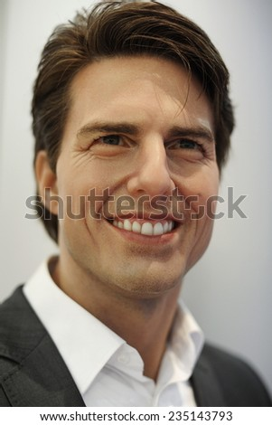 BANGKOK - APR 20: A waxwork of Tom Cruise on display at Madame Tussauds on Apr 20, 2012 in Bangkok, Thailand. Madame Tussauds' newest branch hosts waxworks of numerous stars and celebrities. - stock photo
