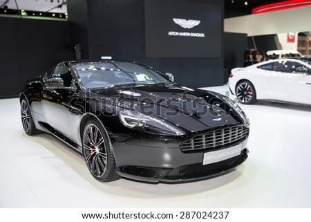 BANGKOK - April 3, 2015 : Aston Martin DB9 carbon Black car on display at The 36th Bangkok International Motor show on April 3, 2015 in Bangkok, Thailand. - stock photo