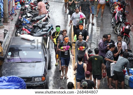 Bangkok April 15:Songkran Festival at Silom Road, Bangkok, is another beat place to celebrate Thai tradition New Year for thais and foreigners on Silom Bangkok April 15,2014 in Thailand - stock photo