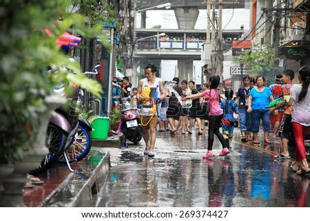 Bangkok April 13:Songkran Festival at Silom Road, Bangkok, is another beat place to celebrate Thai tradition New Year for thais and foreigners on Silom Bangkok April 13,2014 in Thailand - stock photo