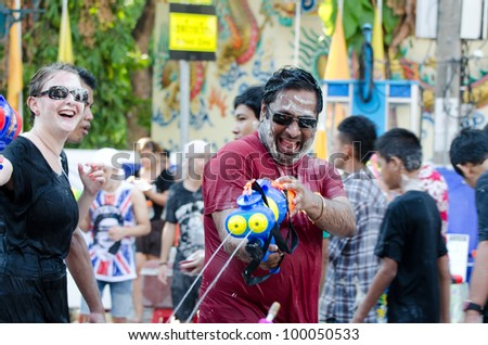 BANGKOK - APRIL 14: Thai people and traveler celebrate Songkran (new year / water festival: 13 April) by giving water  to each others on April 14, 2012 in Bangkok, Thailand. - stock photo