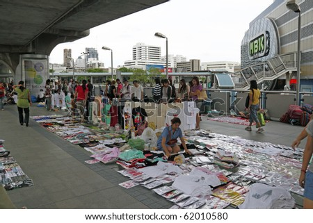 BANGKOK - AUGUST 29: Small Thai traders are given reprise by Thai govt to operate freely at the skytrain in Sukhumvit shopping district on August 29, 2010 after being affected by the Red Shirt protest - stock photo