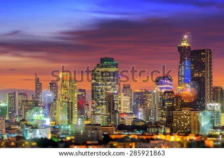 Bangkok business district during twilight sky dramatic with blurred light, Concept combines multiple exposures with bokeh. - stock photo