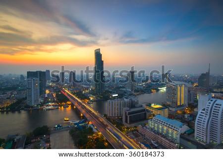 Bangkok city at sunset (Taksin Bridge) - stock photo