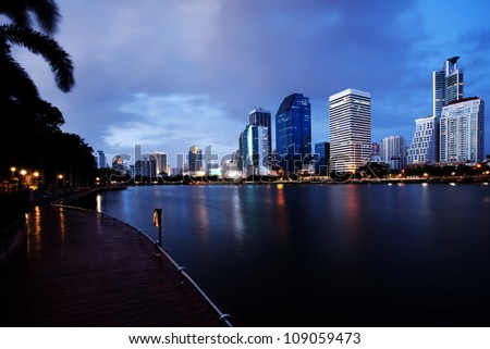 Bangkok city at twilight time with reflection from skyline and building - stock photo