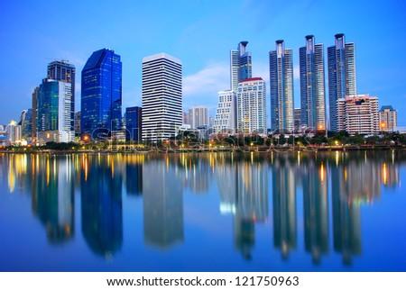 Bangkok city downtown at night with reflection of skyline, Bangkok,Thailand - stock photo