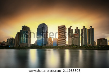 Bangkok city downtown at sunrise with strom in skyline, Bangkok,Thailand - stock photo