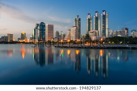 Bangkok city downtown at twilight with reflection of skyline,Benjakitti Park,Bangkok,Thailand  - stock photo