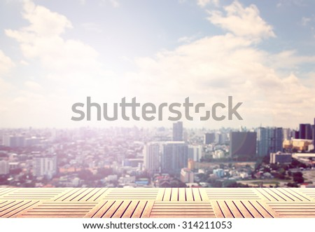 Bangkok city in blur abstract light with fine arranged wood pave - stock photo