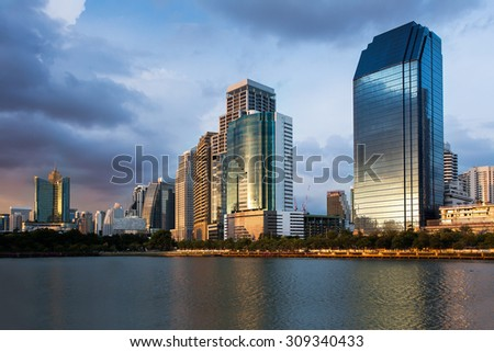 Bangkok Cityscape, Business district with Park in the City at dusk (Thailand) - stock photo