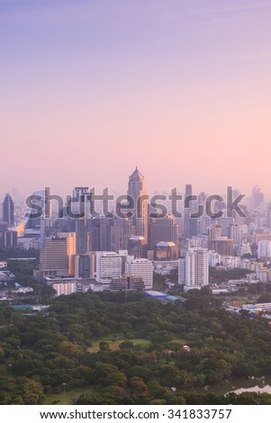 Bangkok cityscape in the morning, view from high building, sun is rising and mist is covering the city  - stock photo