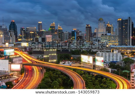 Bangkok cityscape. Traffic on the freeway in the business district. at dusk. - stock photo