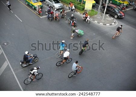 BANGKOK - DEC 9: Above view of unidentified cyclists as they ride on a road in the city centre on Dec 9, 2012 in Bangkok, Thailand. Cycling is growing in popularity in the Thai capital.  - stock photo