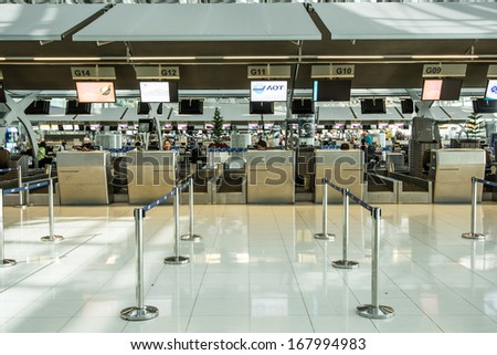 BANGKOK-DECEMBER 16:Empty check in desk in Suvarnabhumi Airport on December 16, 2013 in Bangkok ,Thailand.This airport is handling about 45 million passengers annually. - stock photo