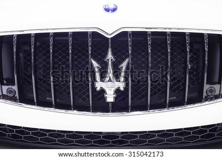 Bangkok - December 28 : logo of Maserati on front grill - in display at Thailand international motor expo 2014 on December 28, 2014 in Bangkok Thailand  - stock photo