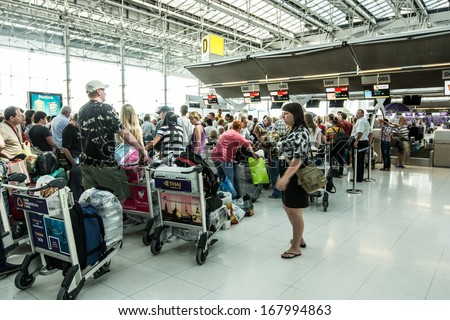 BANGKOK-DECEMBER 16:Passengers arrive at check in desk in Suvarnabhumi Airport on December 16, 2013 in Bangkok ,Thailand.This airport is handling about 45 million passengers annually. - stock photo