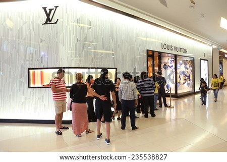 BANGKOK - DECEMBER, 2014 : people waiting in front of Louis Vuitton store in Siam Paragon Mall in Bangkok, Thailand on December 5,2014. - stock photo