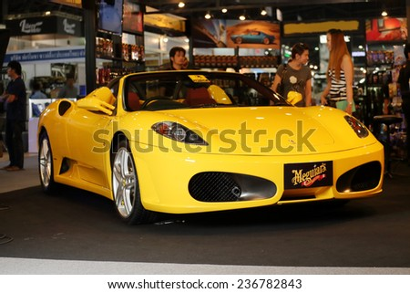 BANGKOK - DECEMBER 9 : Status of yellow Ferrari super sport car by Meguiar's displayed on stage in Motor Expo 2014, on dec. 9, 2014 in Bangkok, Thailand. - stock photo
