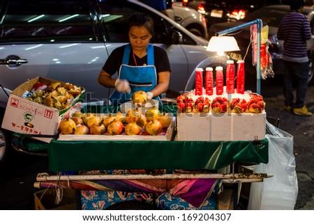 BANGKOK- DECEMBER 31: Thai people sell food by the Yaowarat road on DEC 31, 2013 in Bangkok, Thailand.  - stock photo