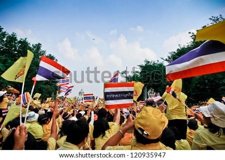 BANGKOK - DECEMBER 5: Thai people sit outside to celebrate for the 85th birthday of HM King Bhumibol Adulyadej on December 5, 2012 in Bangkok, Thailand. - stock photo