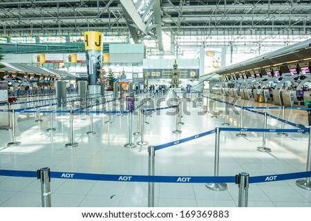 BANGKOK -DECEMBER 24:The departure terminal of Bangkok Suvarnabhumi International Airport on December 24, 2013 in Bangkok, Thailand.This airport is handling about 45 million passengers annually. - stock photo