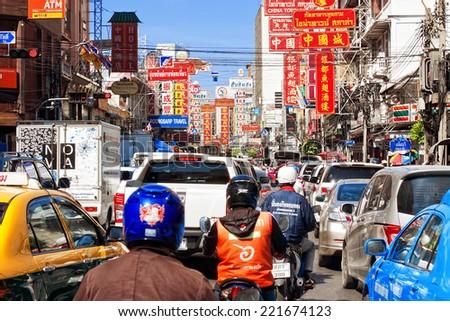 BANGKOK - DECEMBER 17: Traffic jam on Yaowarat Road December 17, 2013 in Bangkok. Thailand. Yaowarat Road is a main street in Bangkok's Chinatown, it was opened in 1891 in the reign of King Rama V. - stock photo