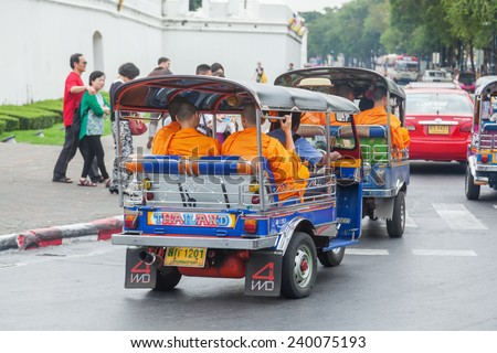 BANGKOK - DECEMBER 13: tuk-tuks with Buddhist monks on December 13, 2014 in Bangkok. Buddist monks live in more than 400 temples and the Buddhist faith is spreaded about 95 percent of the population - stock photo