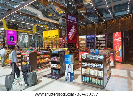 """BANGKOK - DECEMBER 17, 2015: Unidentified people shop goods at the duty free shop """"Thai Snack"""" at the International Airport Suvarnabhumi which is the sixth busiest airport in Asia. - stock photo"""
