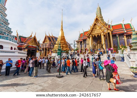 BANGKOK - DECEMBER 16: unidentified visitors at Wat Phra Kaew on December 16, 2014 in Bangkok. Wat Phra Kaew or Wat of the Emerald Buddha is regarded as the most sacred Buddhist temple in Thailand - stock photo