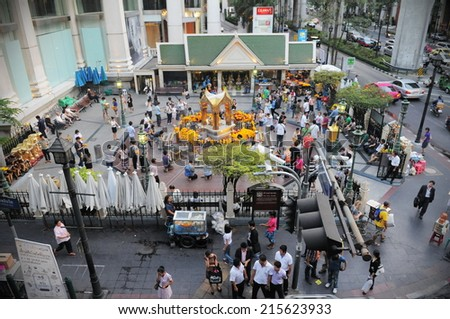 BANGKOK - FEB 11: Temple-goers visit the busy city centre Erawan Shrine on Feb 11, 2011 in Bangkok, Thailand. The Hindu shrine was built in 1956 and has become a popular landmark. - stock photo