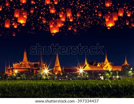Bangkok Grand Palace at night with lantern in the sky, Thailand. - stock photo