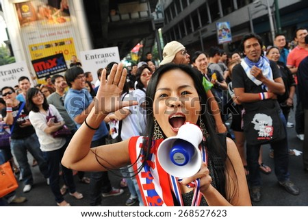 BANGKOK - JAN 24: A protester shouts slogans into a loudhailer during a city centre anti-government rally on Jan 24, 2014 in Bangkok, Thailand. Protesters call for the government to be overthrown. - stock photo