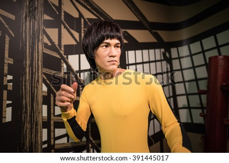 BANGKOK - JAN 29: A waxwork of Bruce Lee on display at Madame Tussauds on January 29, 2016 in Bangkok, Thailand. Madame Tussauds' newest branch hosts waxworks of numerous stars and celebrities - stock photo