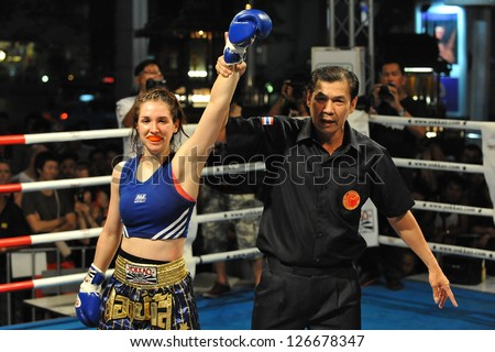 BANGKOK - JAN 23: An unidentified fighter celebrates victory in an amateur Thai Kickboxing match at MBK Fight Night on Jan 23, 2012 in Bangkok, Thailand. Muay Thai is the national sport of Thailand. - stock photo