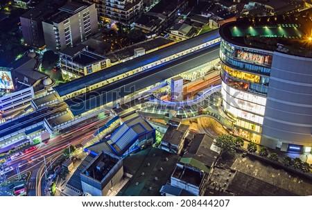 BANGKOK-JAN 4: Elevated rails of Bangkok transit sky train (BTS) at Asoke station on January 4, 2014 in Bangkok,Thailand. Passengers can transfer between BTS and MRT subway transit at this station. - stock photo