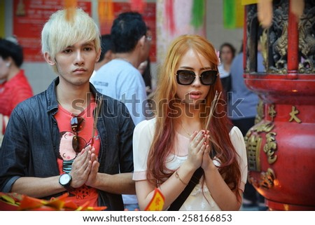 BANGKOK - JAN 30: Temple goers gather to make merit at a Chinatown Taoist-Buddhist shrine during festivities ushering in the Chinese New Year on Jan 30, 2014 in Bangkok, Thailand. - stock photo