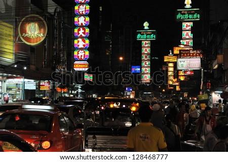 BANGKOK - JAN 7: Vehicles make there way along Yaowarat Road, the main street in Bangkok's Chinatown, on Jan 7, 2013 in Bangkok, Thailand. Yaowarat was opened in 1891 in the reign of King Rama V. - stock photo