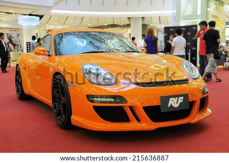 BANGKOK - JAN 23: View of RUF modified Porsche on show at CentralWorld shopping mall on Jan 23, 2011 in Bangkok, Thailand. RUF has a large share of the high-end luxury sports car market in Thailand. - stock photo