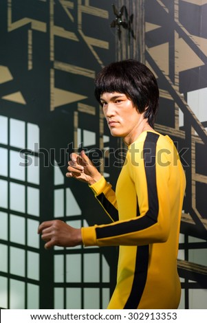 BANGKOK - JUL 22:: A waxwork of Bruce Lee on display at Madame Tussauds on on July 22, 2015 in Bangkok, Thailand. Madame Tussauds' newest branch hosts waxworks of numerous stars and celebrities. - stock photo