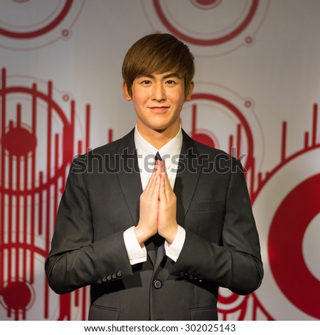 BANGKOK-JUL 22:: A waxwork of Nichkun Horvejkul on display at Madame Tussauds on on July 22, 2015 in Bangkok, Thailand. Madame Tussauds' newest branch hosts waxworks of numerous stars and celebrities - stock photo