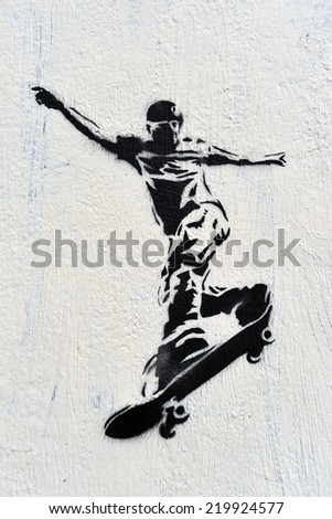 BANGKOK - JULY 18: View of a skateboarding themed stencil graffiti piece by an unidentified artist on a city centre wall on July 18, 2013 in Bangkok, Thailand. Bangkok has a vibrant street art scene. - stock photo