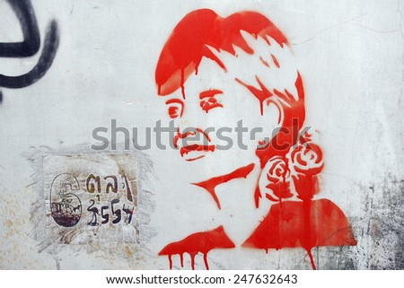 BANGKOK - JUN 1: View of stencil graffiti on a city centre wall of Aung San Suu Kyi by an unidentified artist on Jun 1, 2013 in Bangkok, Thailand. The Thai capital is known for its vibrant street art. - stock photo