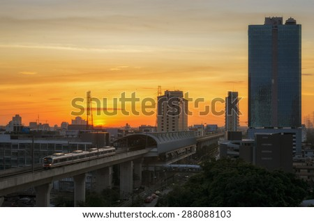 BANGKOK - June 16: A BTS Skytrain in the city on June16, 2015 in Bangkok, Thailand. Each train of the mass transport rail network can carry over 1,000 passengers. - stock photo